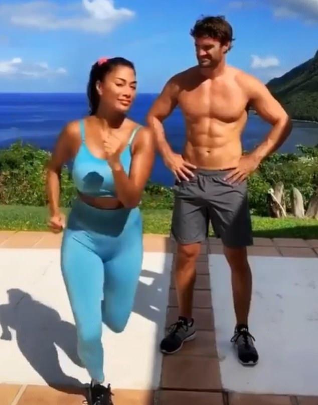 Nicole Scherzinger wearing skinny blue high waist workout leggings