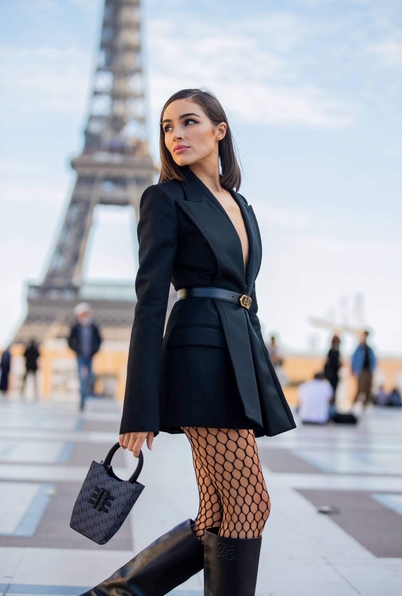 Olivia Culpo wearing a black structured Fendi satin tuxedo with a silk fabric, long sleeves, lapel collar and flap pockets