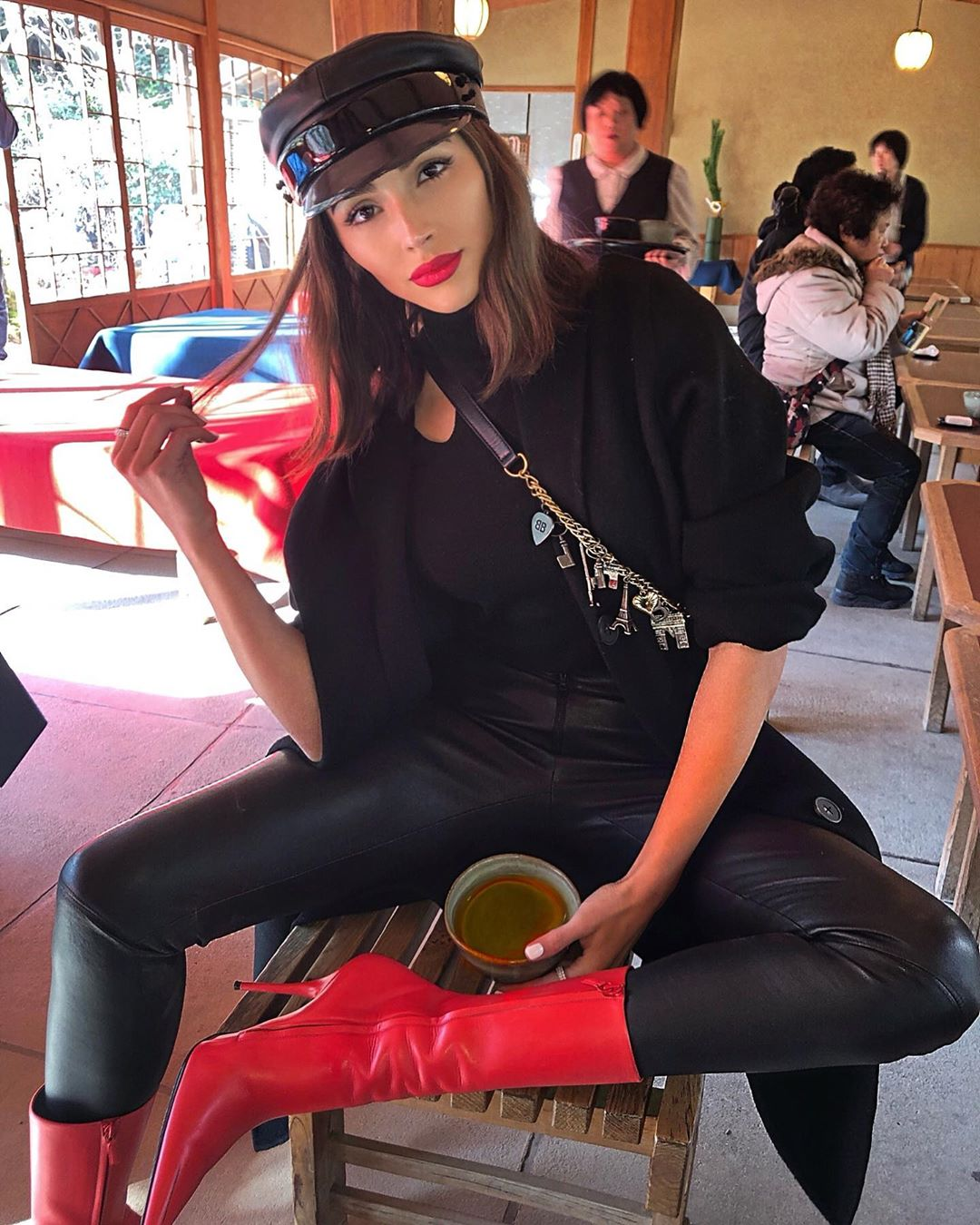 Olivia Culpo donning black jeans with a leather material
