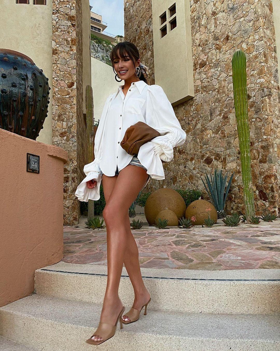 Olivia Culpo donning Nude Bottega Veneta open toe sandals with high heel
