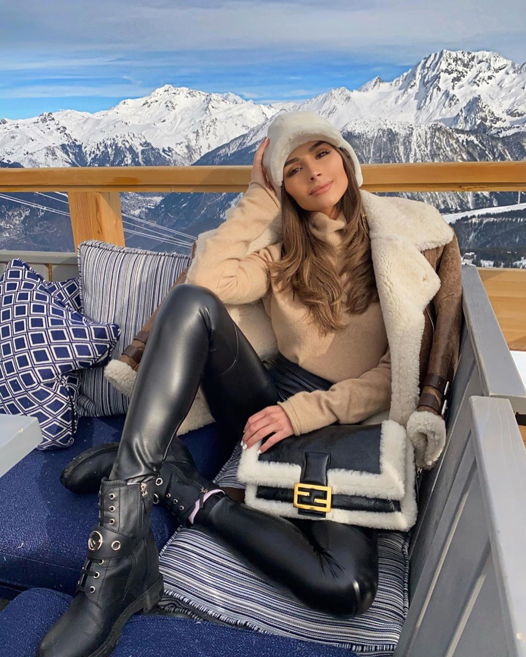 Olivia Culpo wearing black pants with a leather fabric
