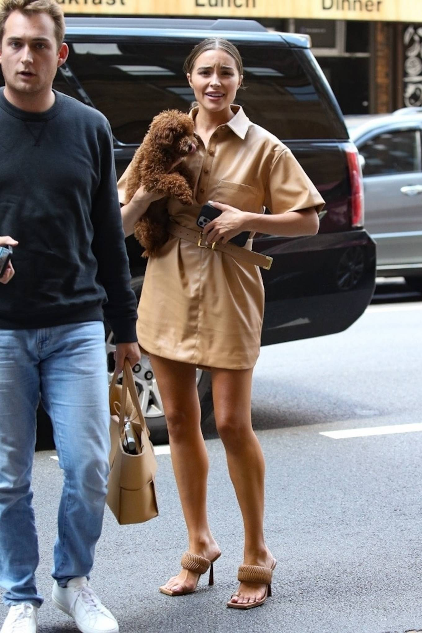 Olivia Culpo rocking square beige Gia Couture slip on sandals with interwoven strap detailing