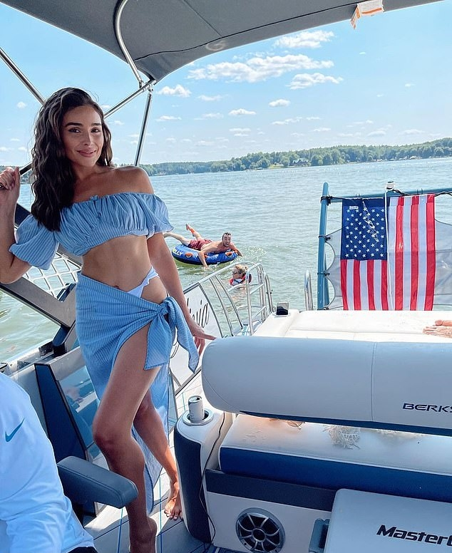 Olivia Culpo donning a frilly off-shoulder crop top with bell sleeves and ruched