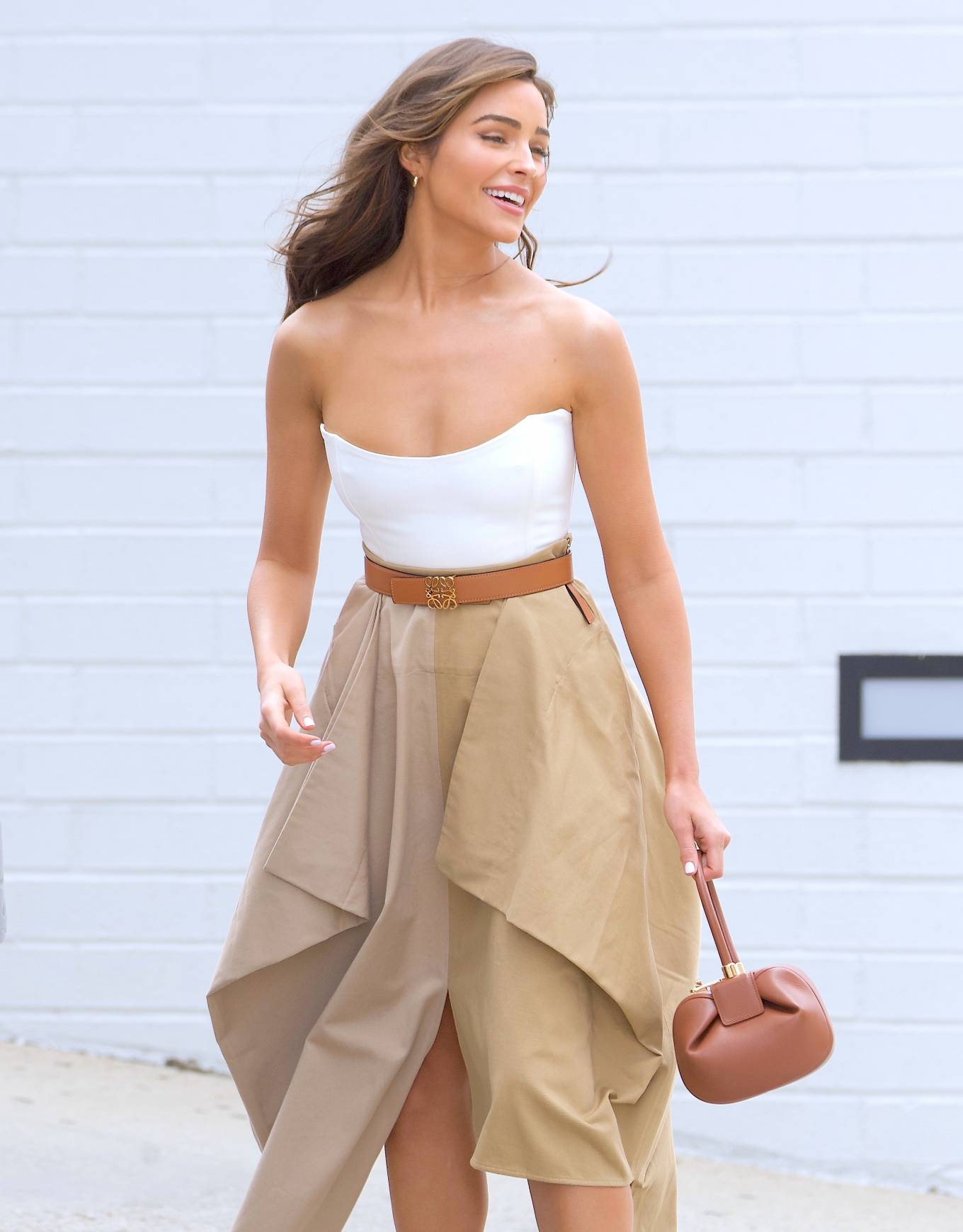 Olivia Culpo donning a figure hugging white corset with a scoop neck