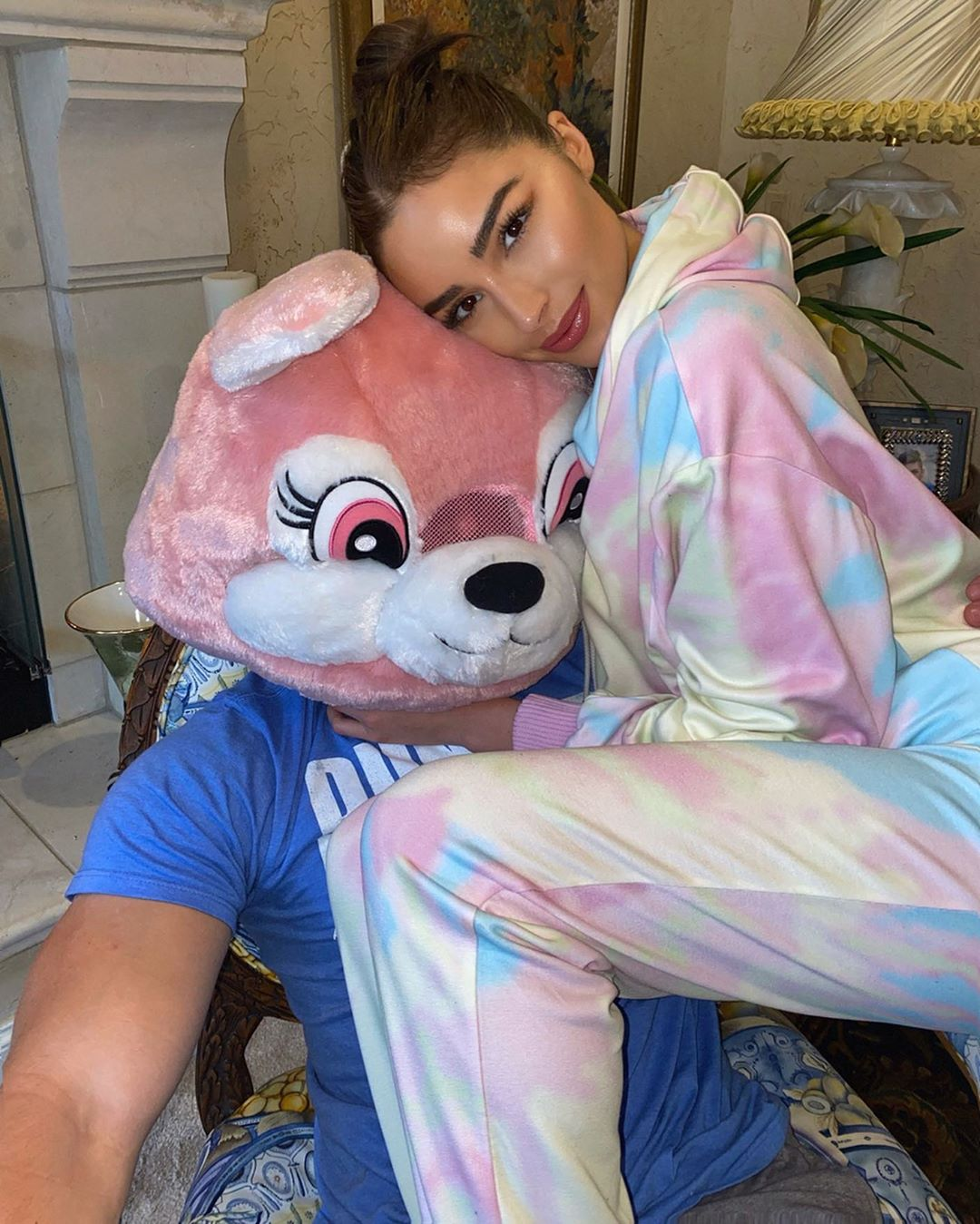 Olivia Culpo rocking Relaxed fit pink tie dye Ralph & Russo track pants with pattern and ribbed trim hem