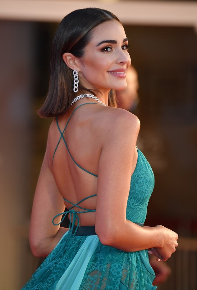 Olivia Culpo rocking a plunging blue dress with spaghetti straps