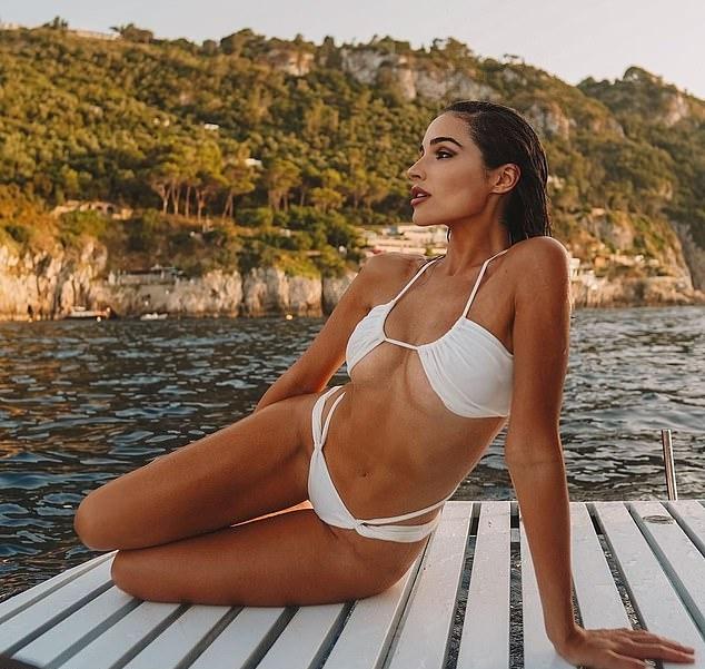 Olivia Culpo stunned in a skimpy white bikini top with spaghetti straps