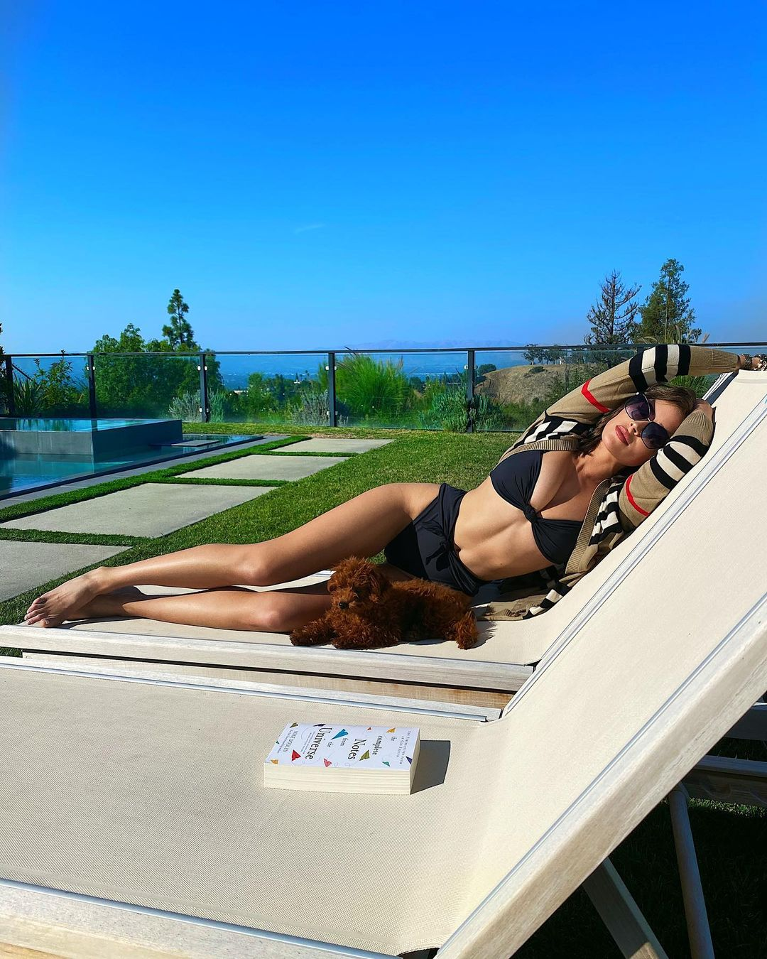 Olivia Culpo donning Skimpy black high rise bikini bottom