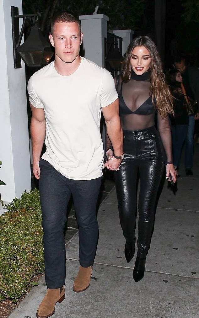 Olivia Culpo wearing Narrow fit black leather pants with a leather material
