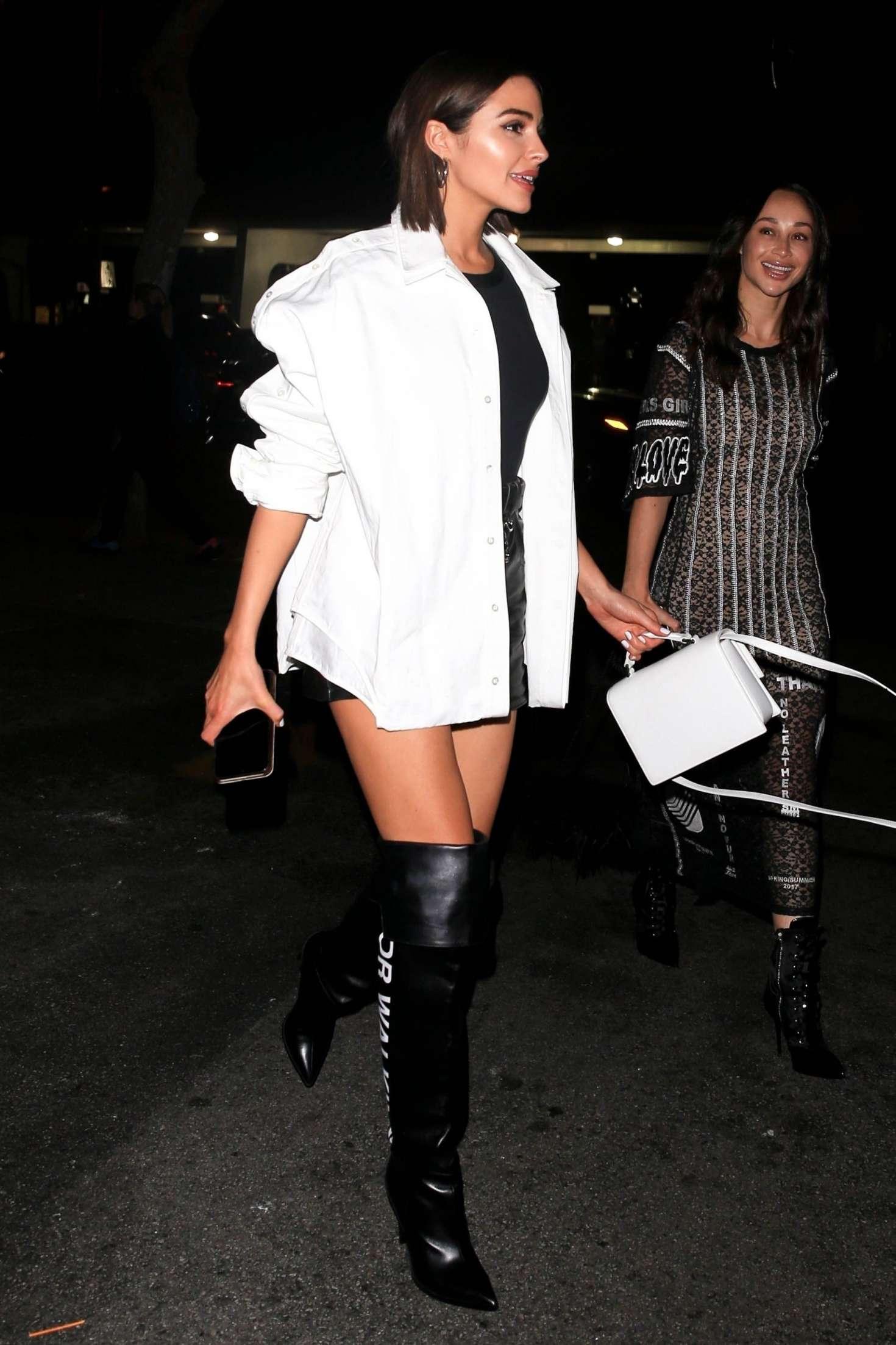 Olivia Culpo rocking baggy black leather high rise romper shorts