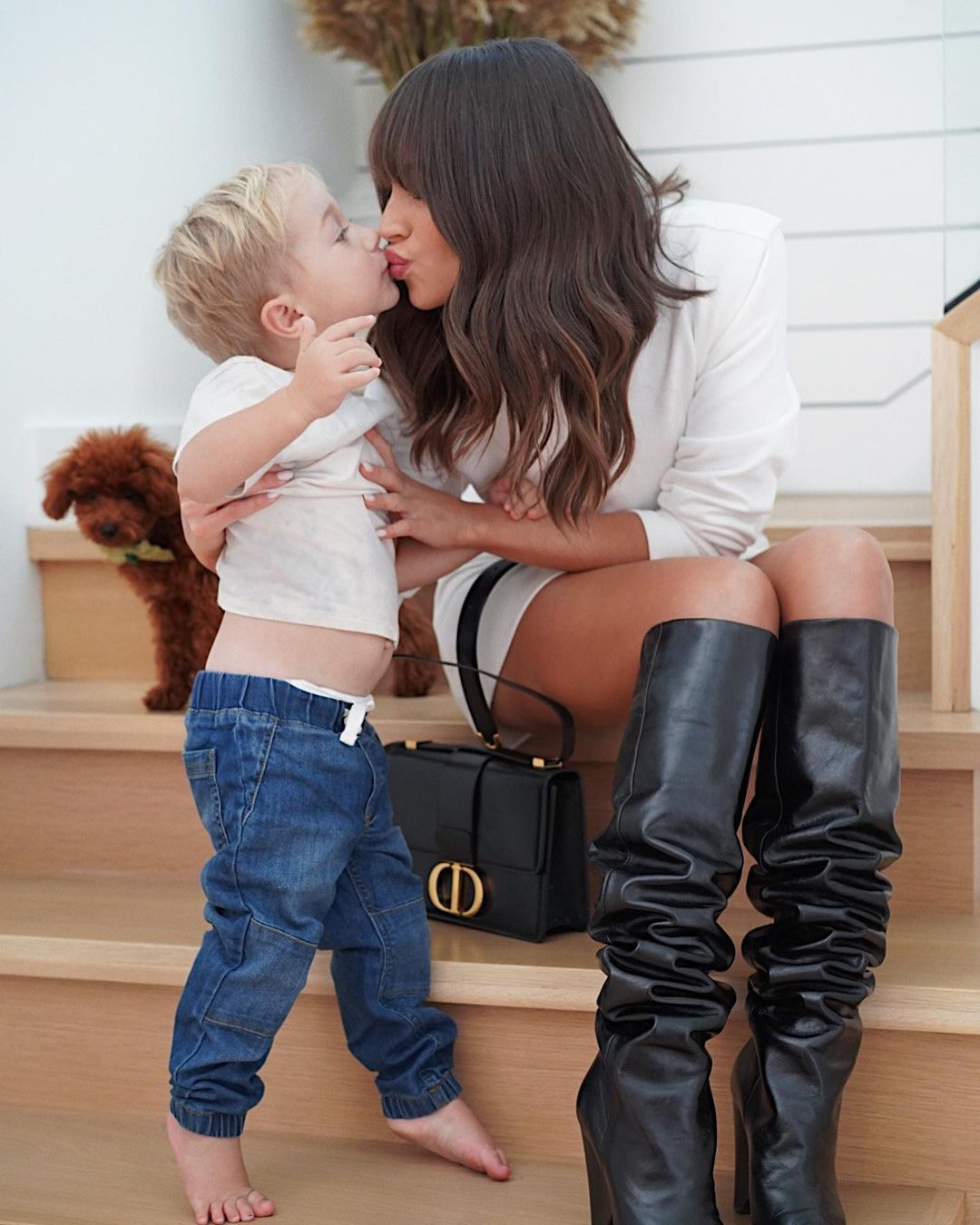 Olivia Culpo rocking pointy black leather thigh high boots