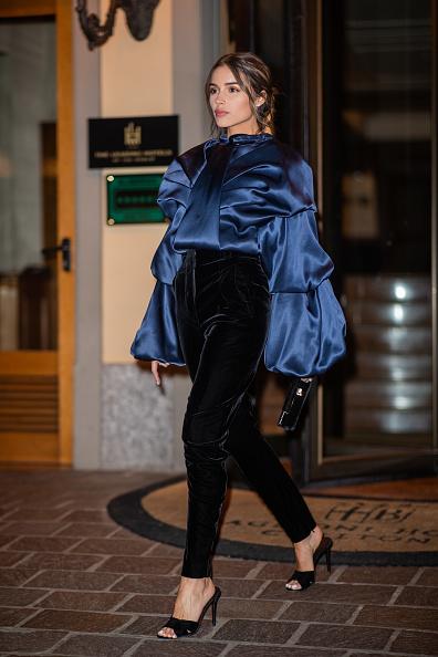 Olivia Culpo donning narrow fit shiny black luxe velvet pants
