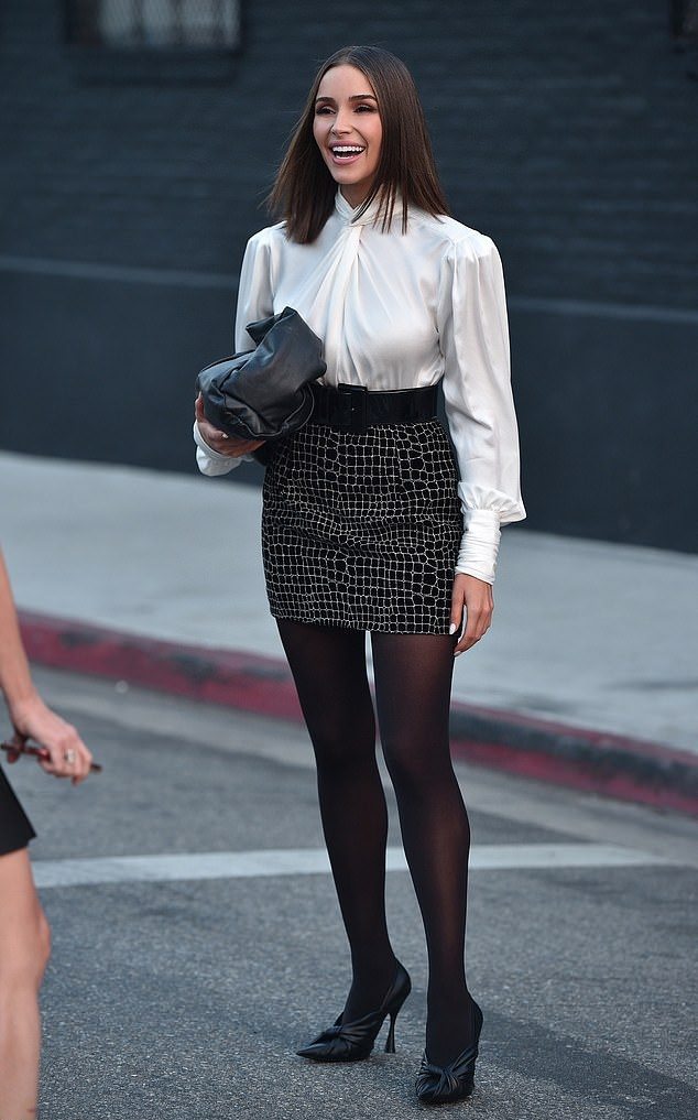 Olivia Culpo rocking pointy black leather pumps with high heel