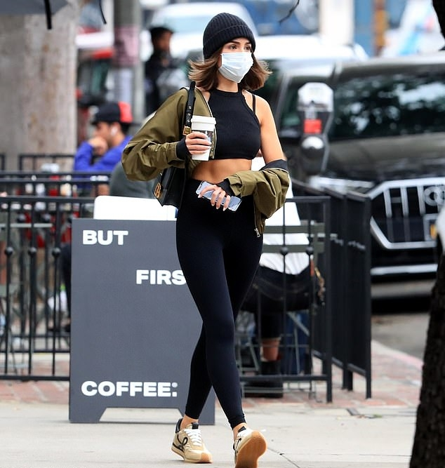 Olivia Culpo donning round tan brown lace-up sneakers by Loewe with 'Anagram' logo