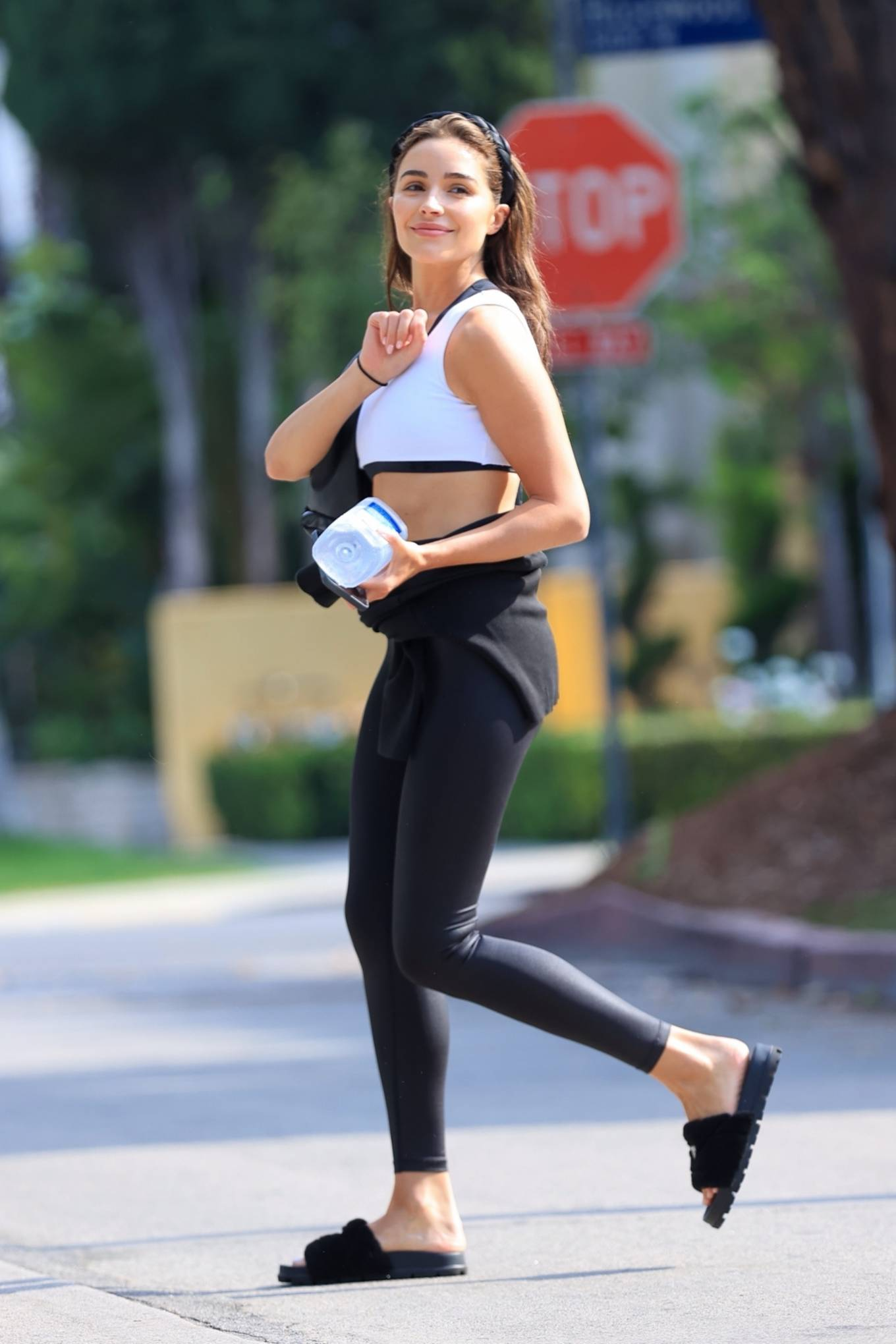 Olivia Culpo donning round black open toe slippers