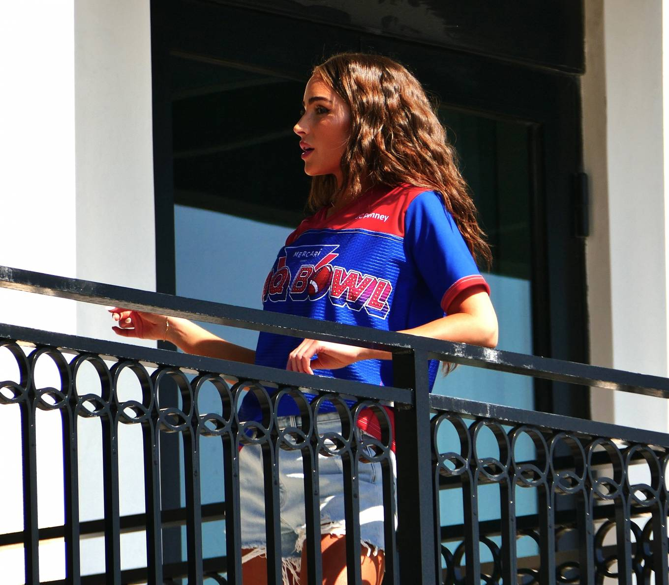 Olivia Culpo donning a blue red printed tee with short sleeves and a V-neck