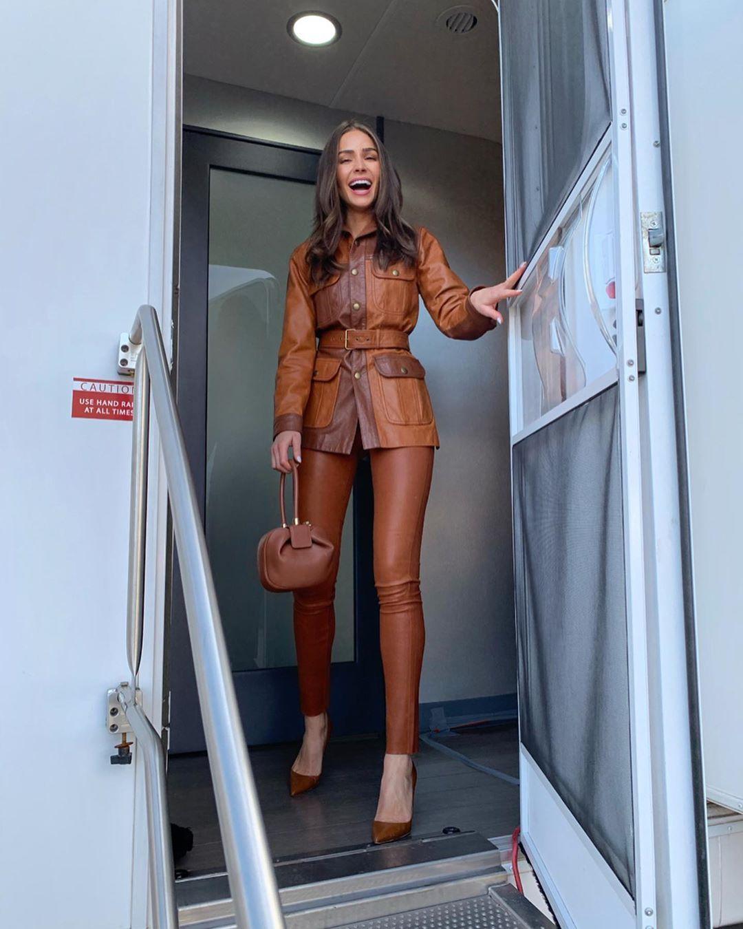 Olivia Culpo rocking skinny brown leather jeggings