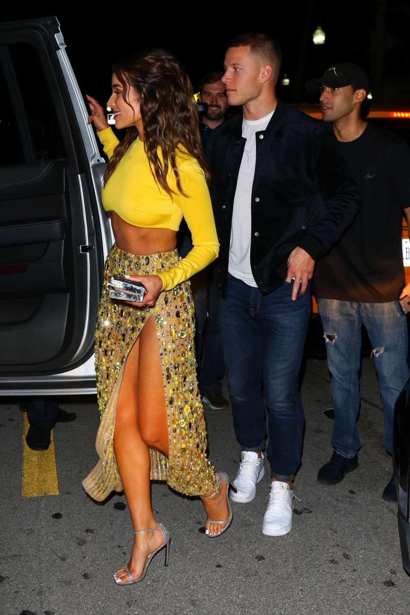 Olivia Culpo sparkled in silvery grey open toe sandals with high heel and thin straps
