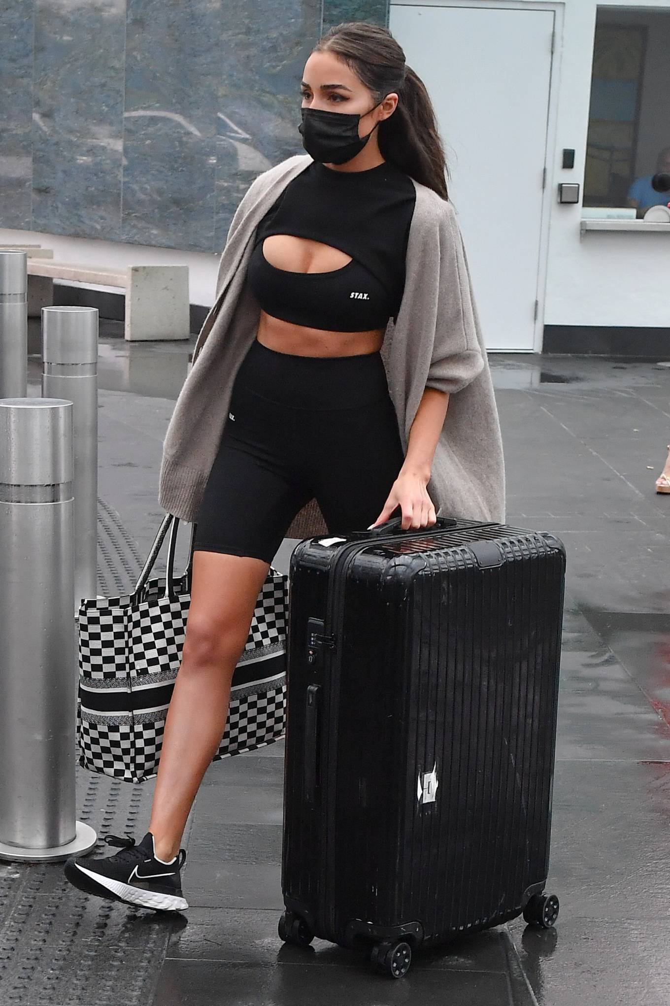 Olivia Culpo donning black Nike lace-up sneakers