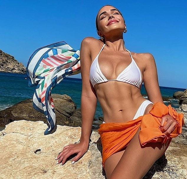 Olivia Culpo donning skimpy white low rise skinny bikini bottom