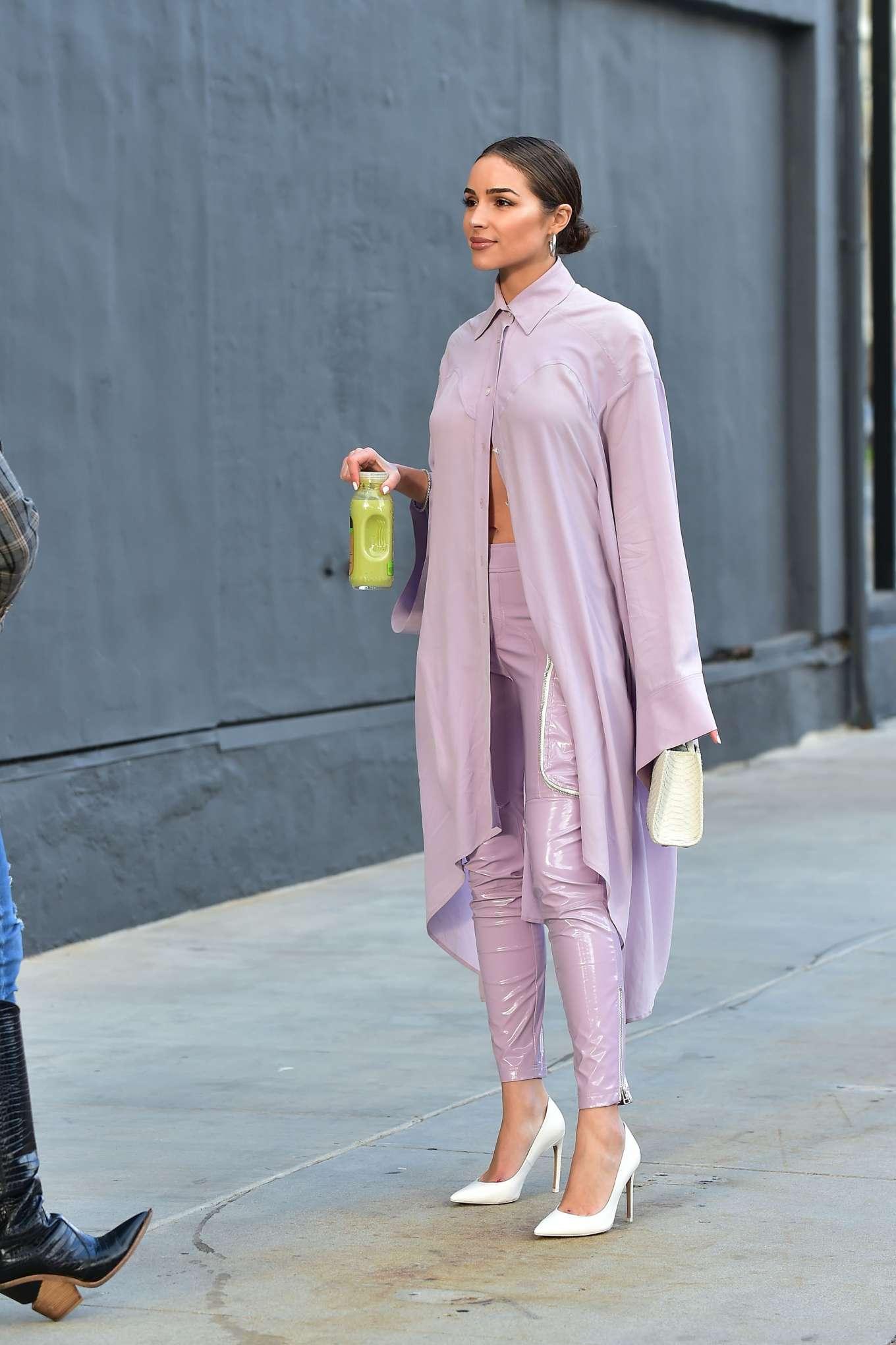 Olivia Culpo donning Shiny mauve skinny pants