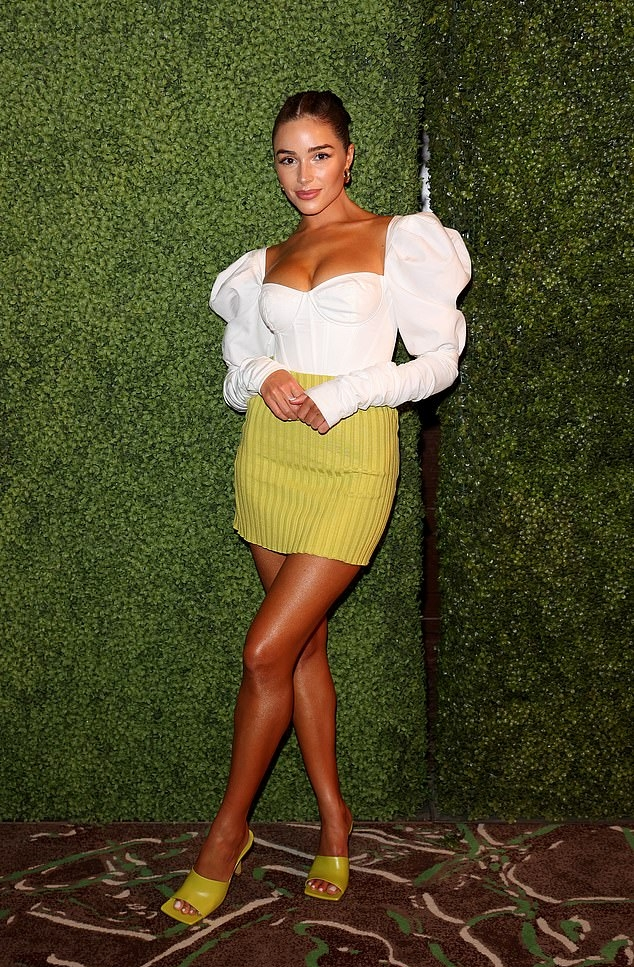 Olivia Culpo donning square olive green slip on slide on sandal by Bottega Veneta with high heel