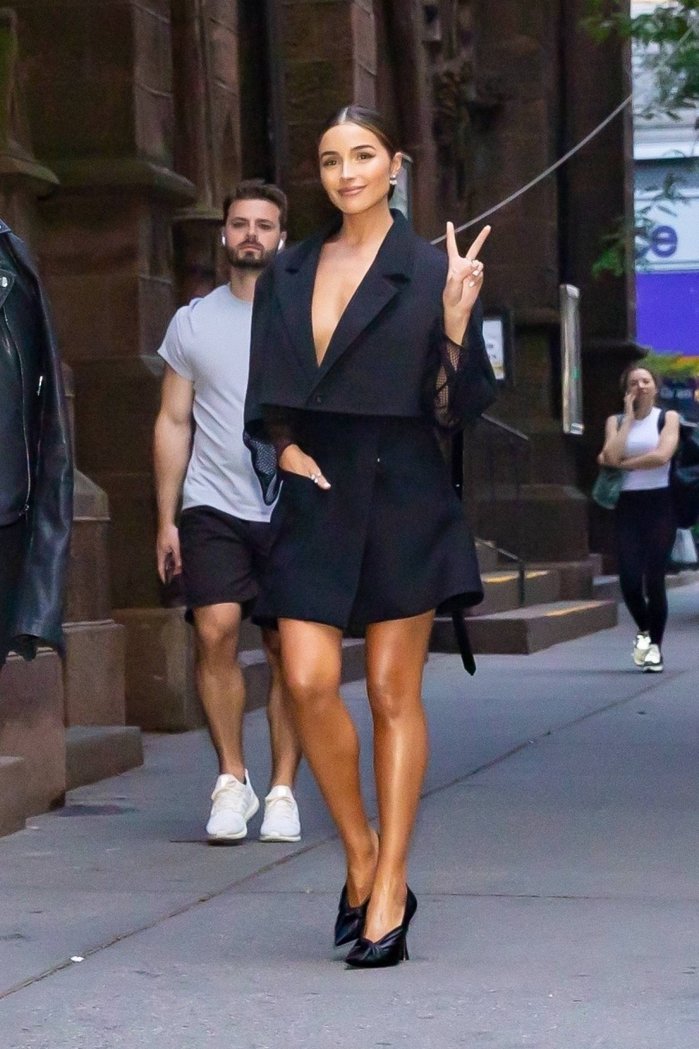 Olivia Culpo rocking a black cropped Louis Vuitton fishnet crop jacket with a cotton material, full sleeves and lapel collar