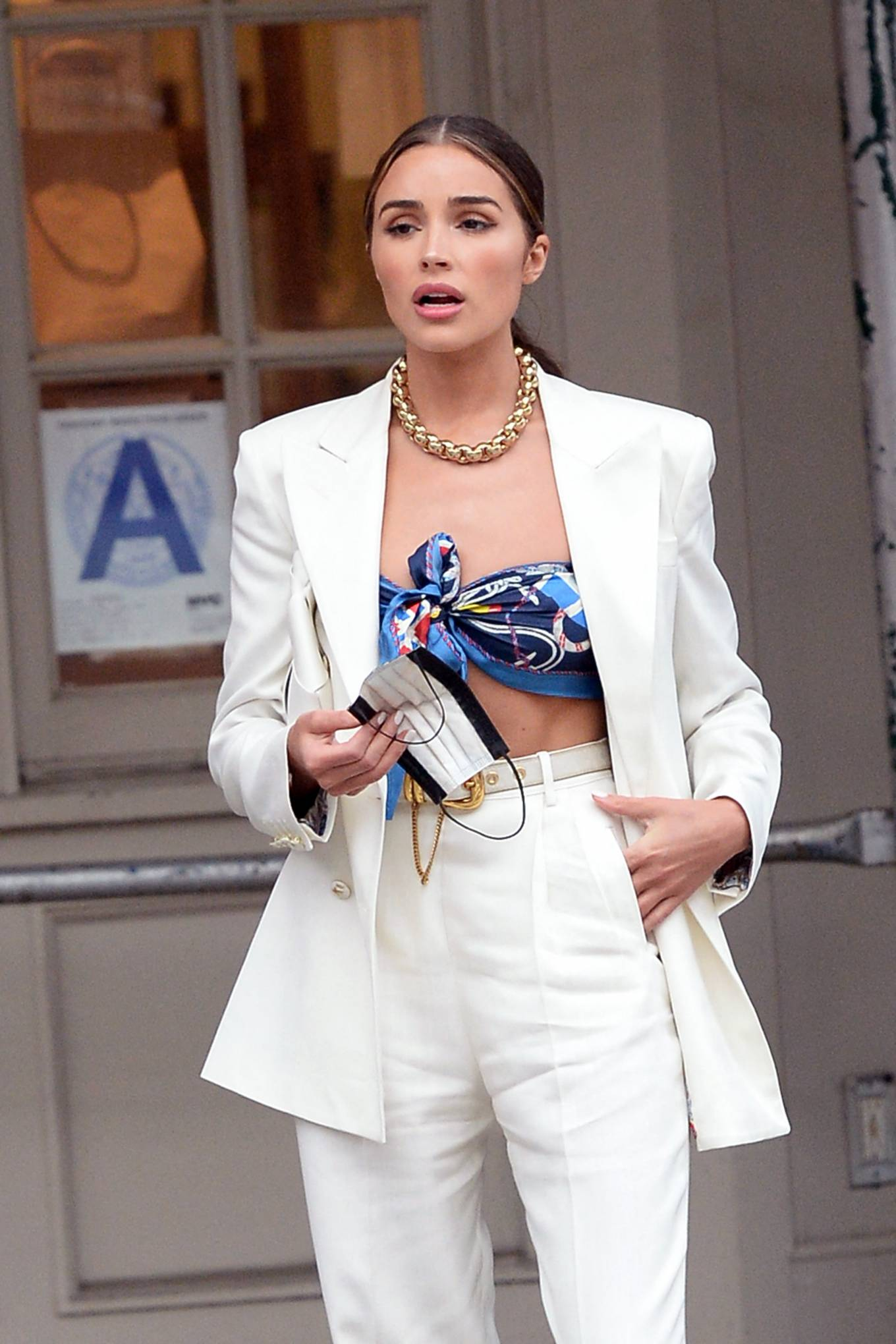 Olivia Culpo wearing square white Bottega Veneta open toe sandals with high heel