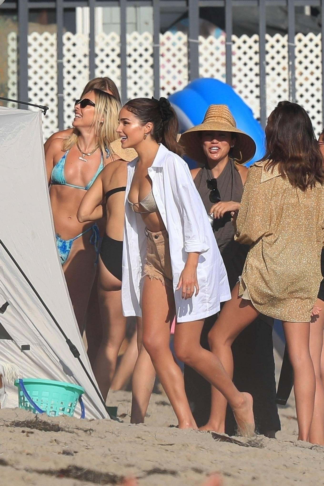 Olivia Culpo wearing ripped nude denim shorts