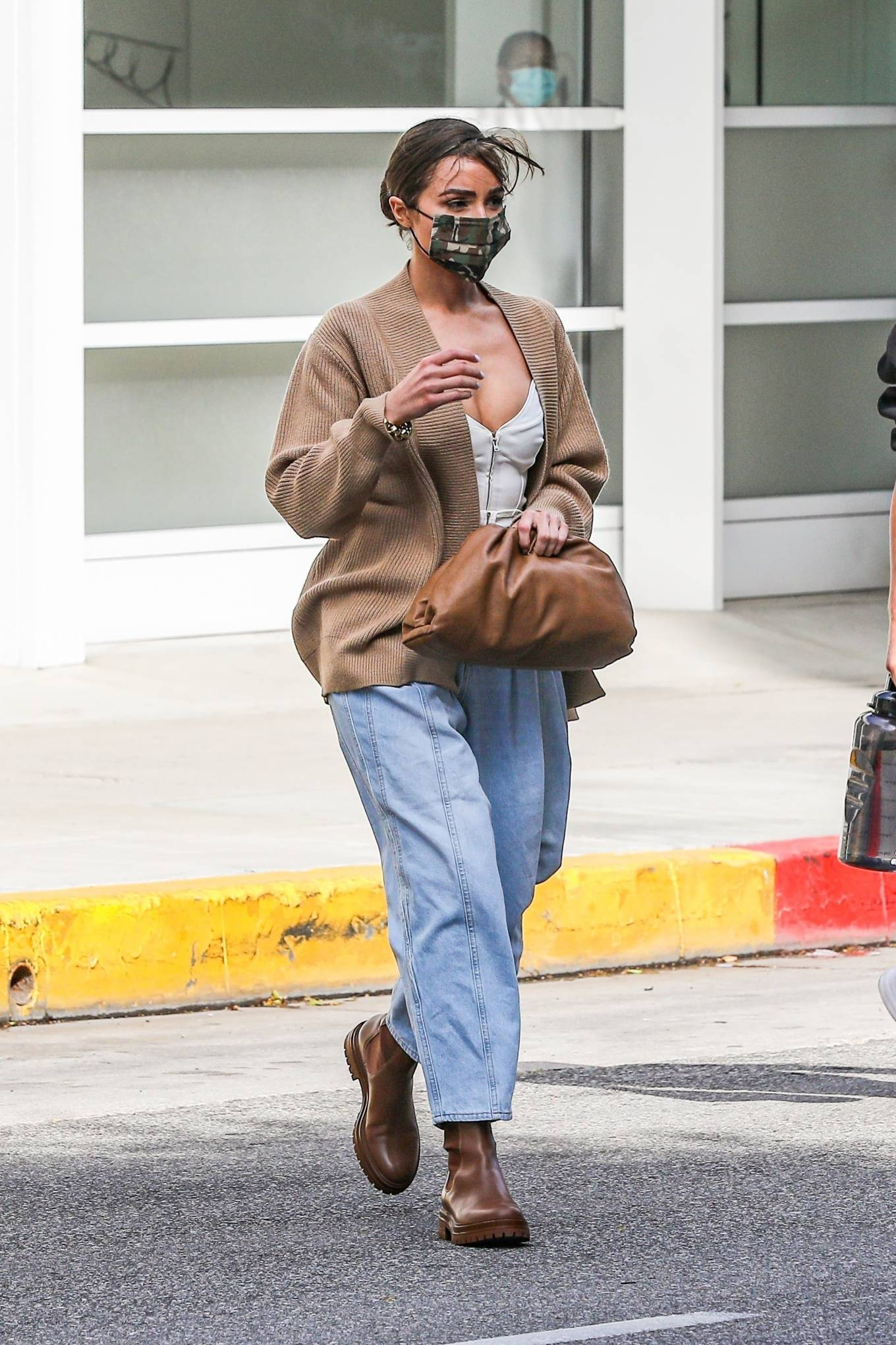 Olivia Culpo donning round brown boots