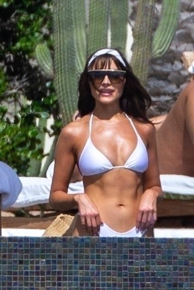 Olivia Culpo rocking White bikini bottom