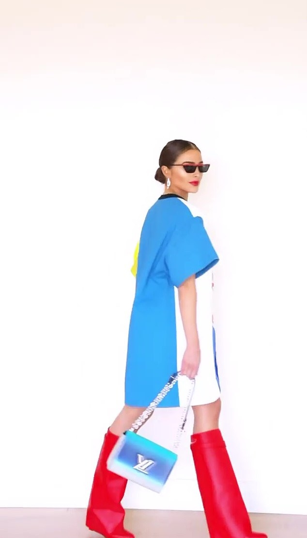 Olivia Culpo, Louis Vuitton  dress, silk, red boots, crew neck, graphic print, cotton, thigh skimming, half sleeves, Louis Vuitton  slip dress, oversized, blue Louis Vuitton satchel, black sunglasses