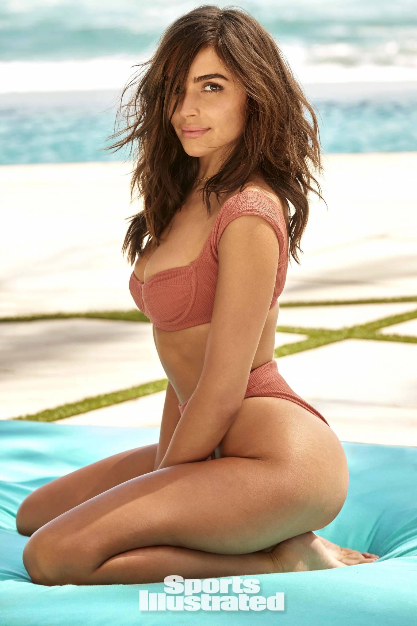 Olivia Culpo wearing sexy nude pink ribbed bikini bottom