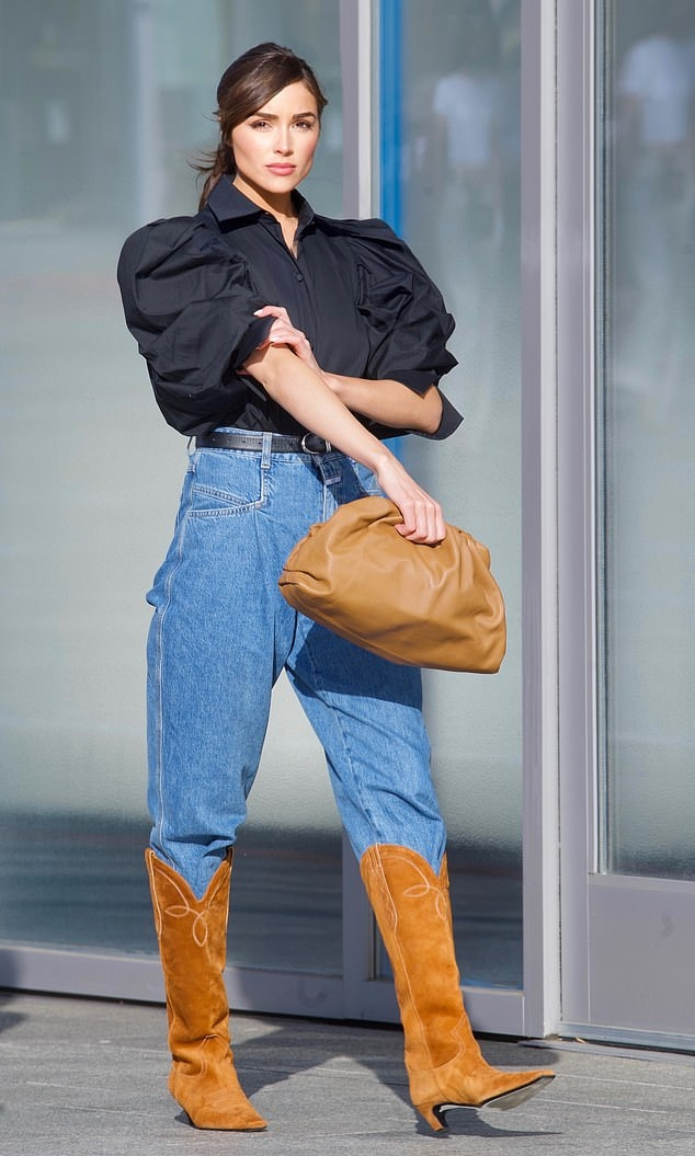 Olivia Culpo rocking stitched brown tan knee high cowboy boots with kitten heel
