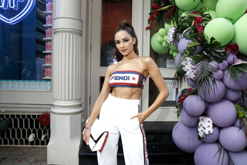 Olivia Culpo wowed in casual white jersey knit track pants by Fendi