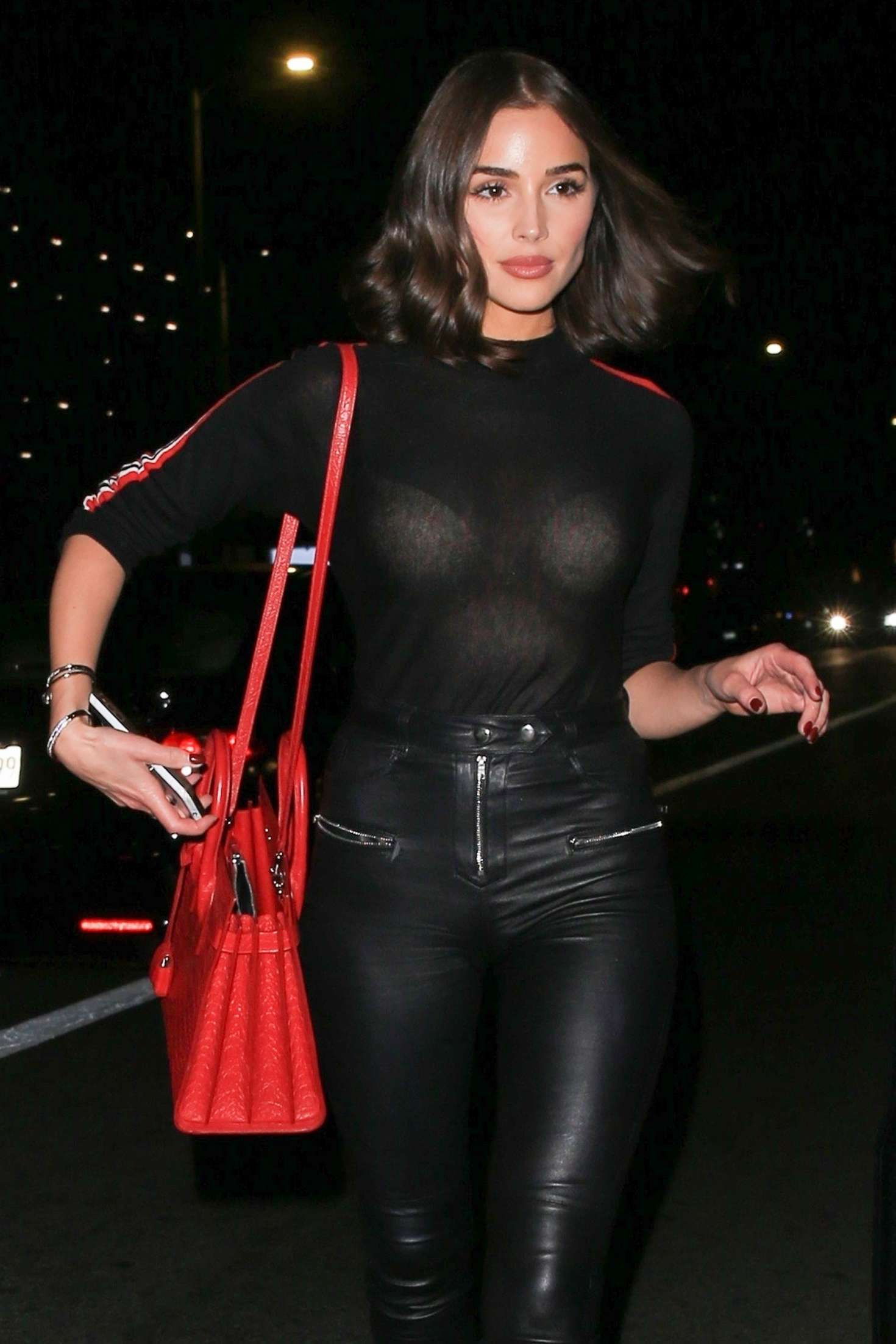 Olivia Culpo rocking cropped black leather ankle length jeans