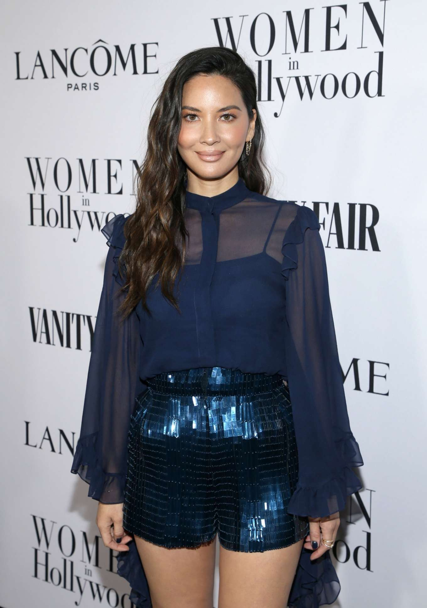 Olivia Munn sparkled in striking navy blue skinny shorts with a sequin material