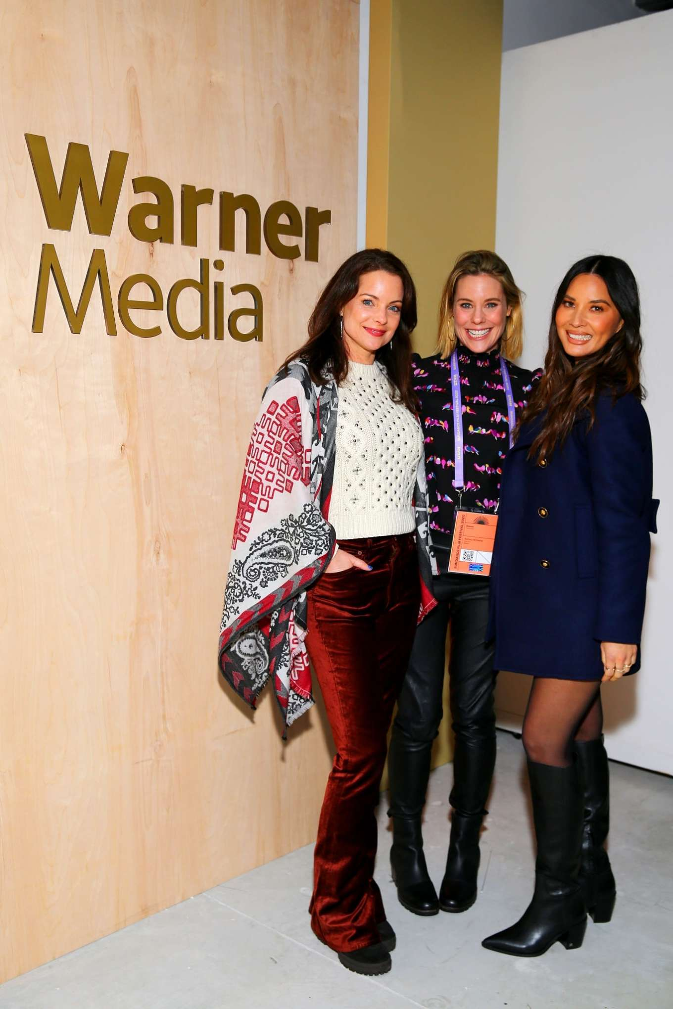 Olivia Munn rocking pointy black leather boots with block heel
