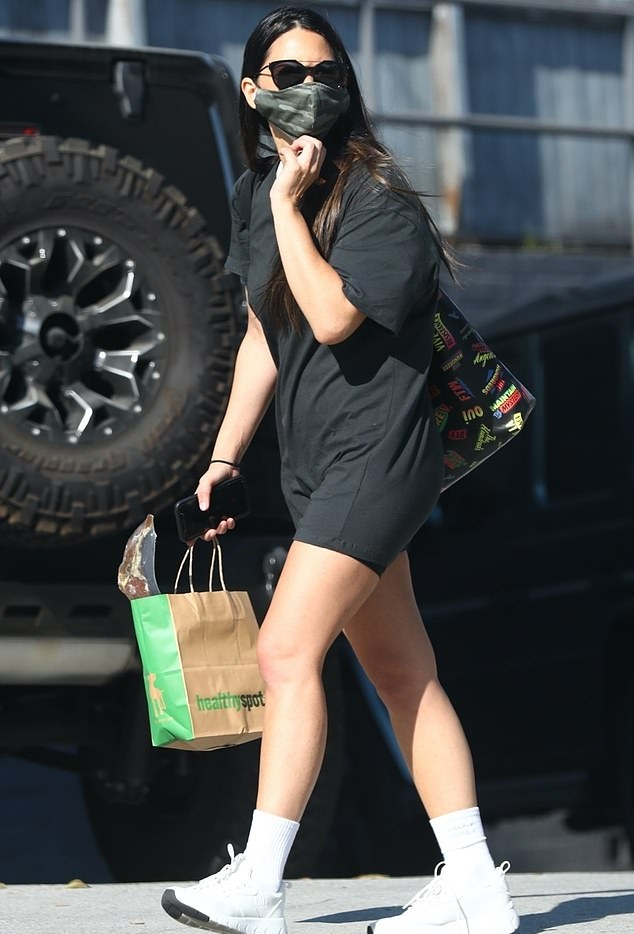 Olivia Munn donning chunky white lace-up sneakers