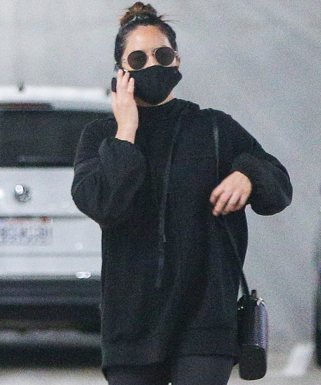 Olivia Munn donning black mesh lace-up sneakers