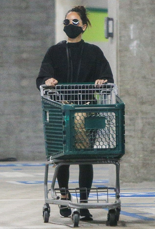Olivia Munn donning a oversized black pullover with full sleeves and a high neck