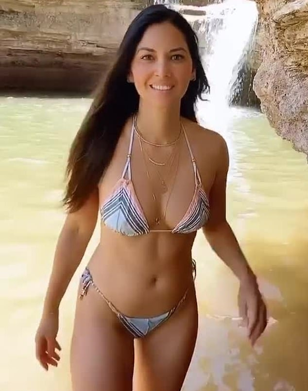 Olivia Munn rocking Skimpy light grey striped bikini bottom with striped