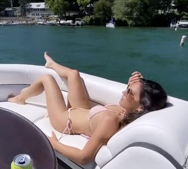 Olivia Munn rocking a Plunging nude bikini top with spaghetti straps