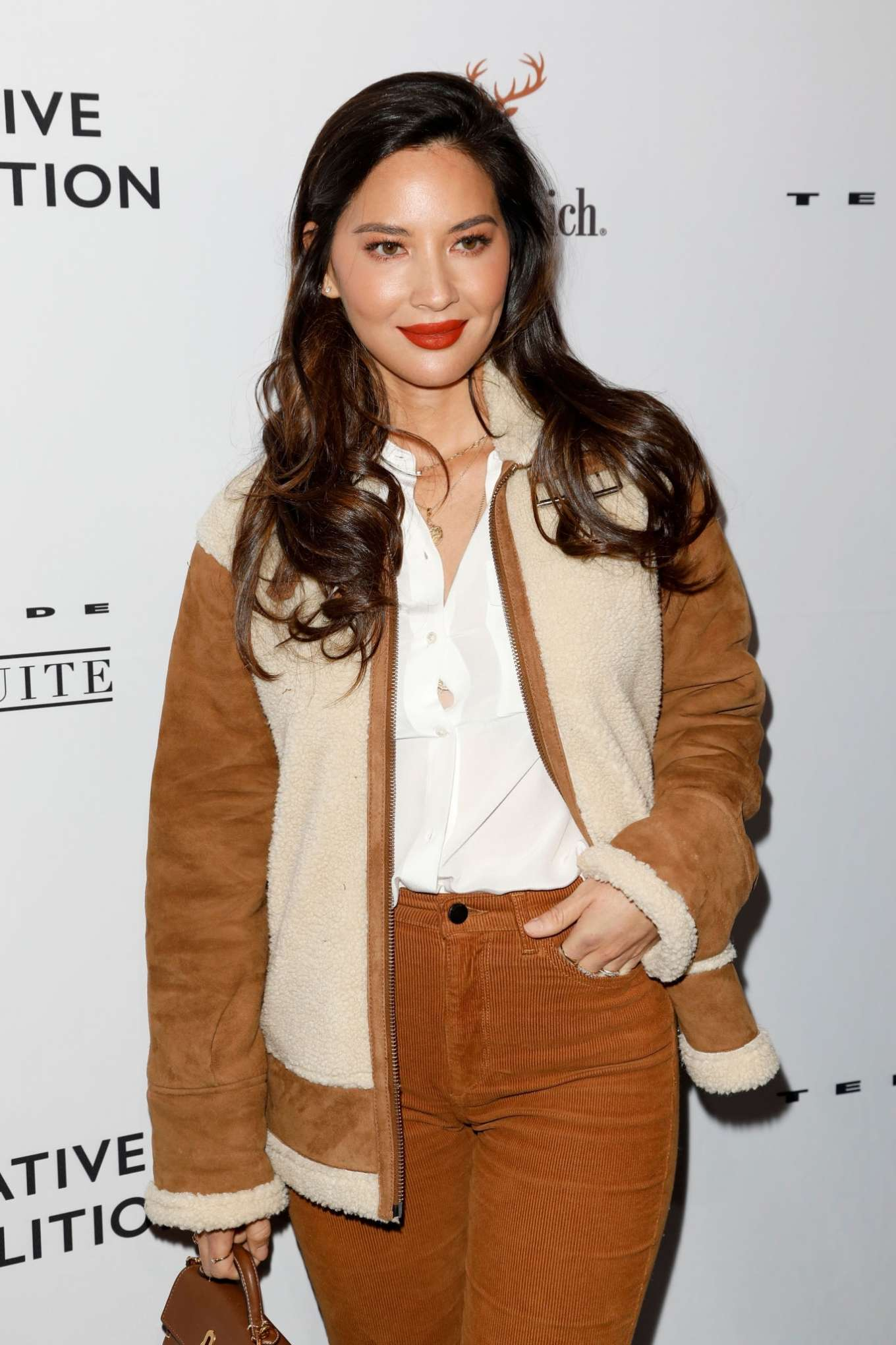Olivia Munn donning pointy tan suede boots with high heel