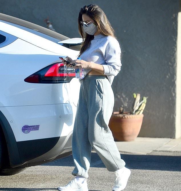 Olivia Munn wearing baggy grey high waist sweatpants