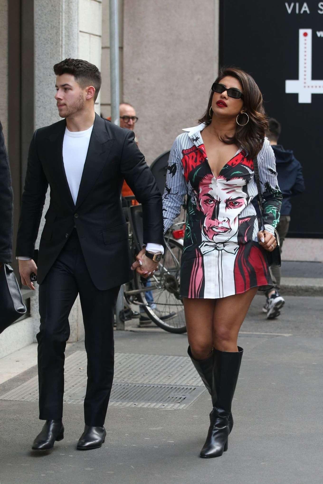 Priyanka Chopra wearing narrow black leather knee high boots with high heel