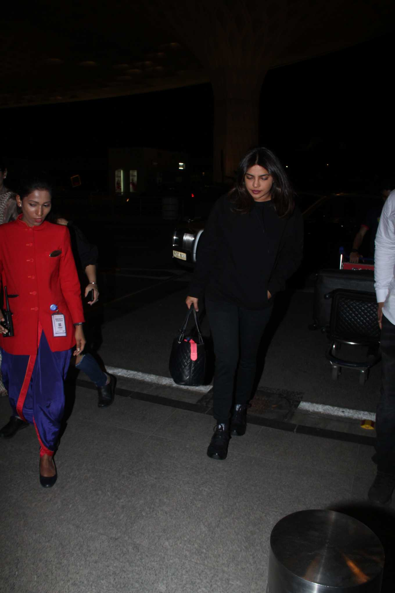 Priyanka Chopra rocking black leather lace-up sneakers