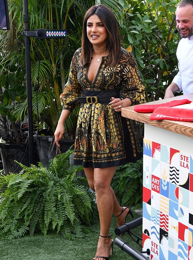Priyanka Chopra rocking black leather open toe sandals with high heel and thin ankle strap