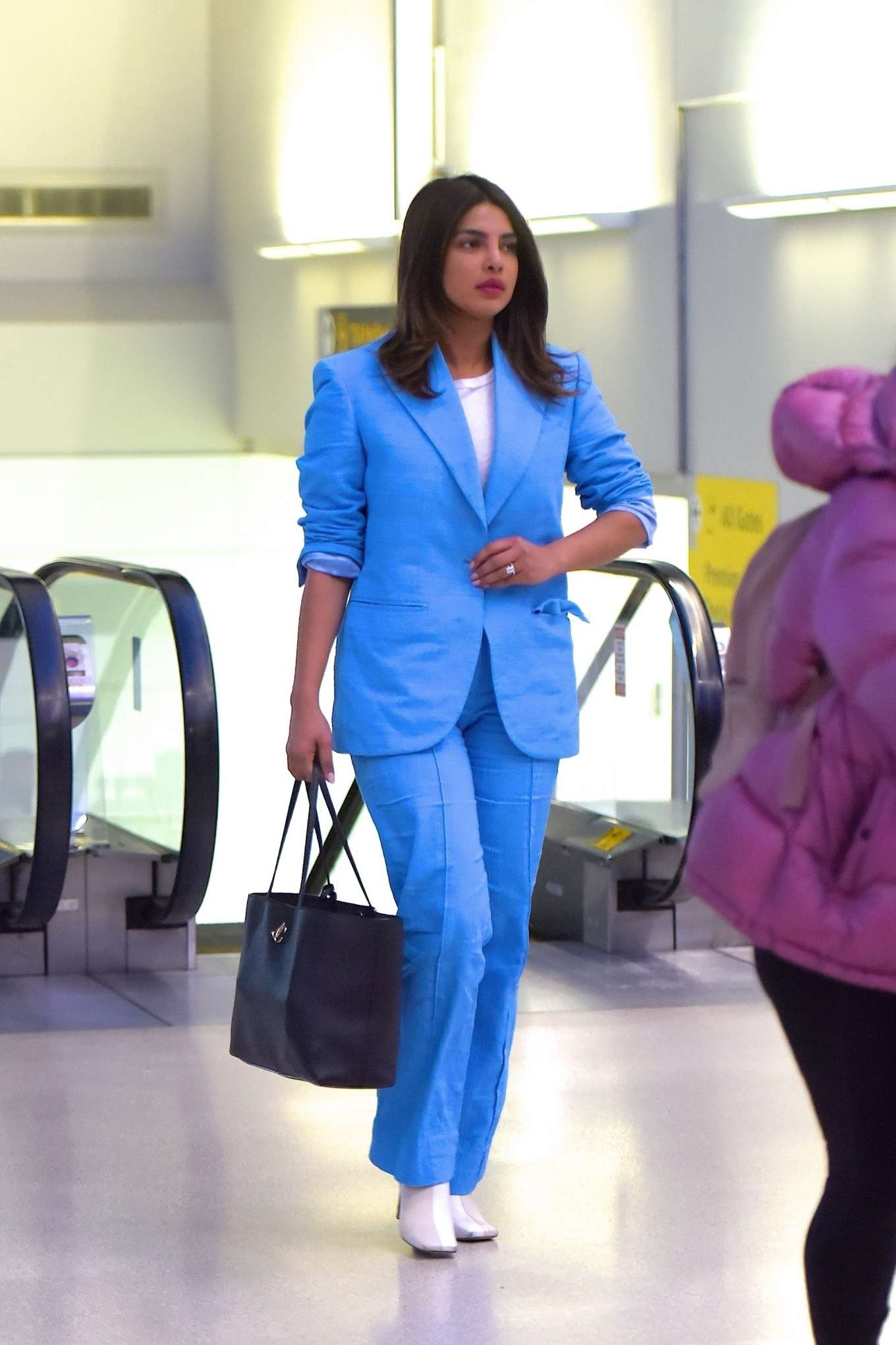 Priyanka Chopra rocking narrow white leather boots with high heel
