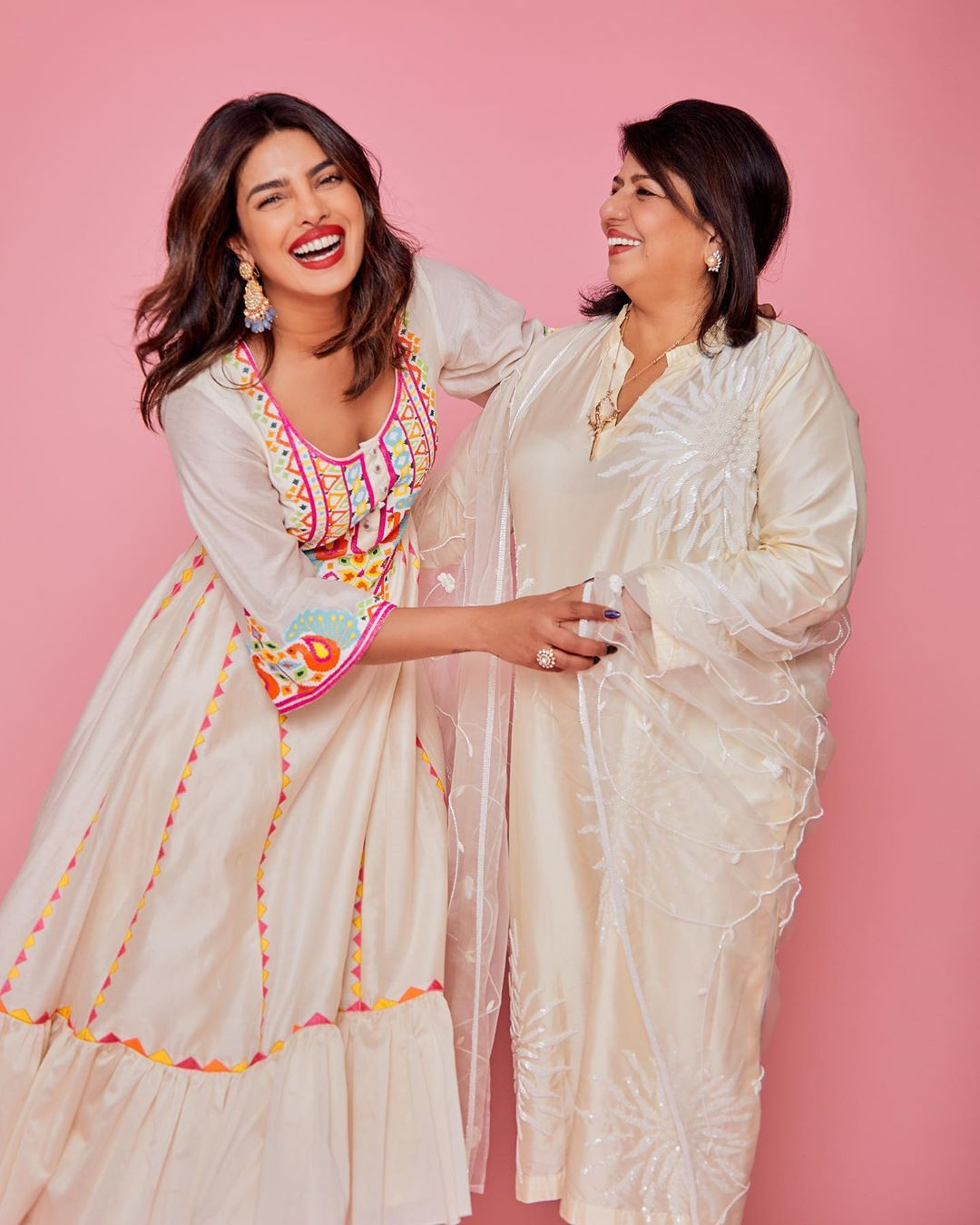 Priyanka Chopra donning Matching white silk flowing palazzo with flared hem with pleated, a silk fabric and flared hem